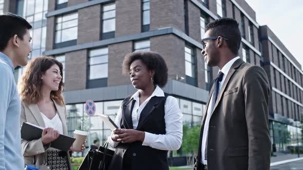 Thumbnail for African Businesswoman Chatting with Colleagues and Smiling