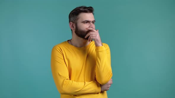 Thinking Man Looking Up on Blue Background