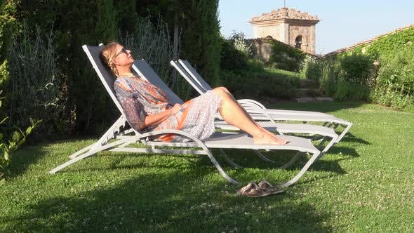 Thumbnail for Resting sitting in a lounge chair in a small village in Tuscany, Italy, Europe.