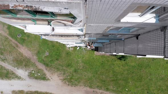 Aerial View Industrial Climber Perform Work on Insulation Side Facade Building