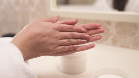 Thumbnail for A Close-up of Woman's Hands with Manicure Applying Cream