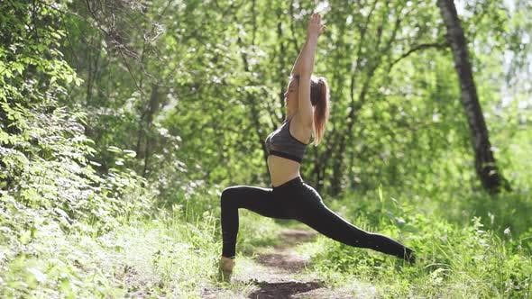 Thumbnail for Young Healthy Woman Doing Stretching Exercises on Grass Outdoors