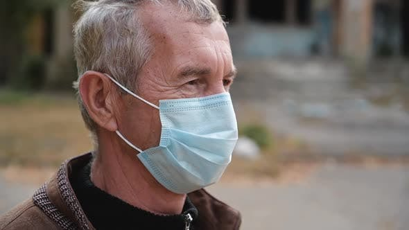 Thumbnail for Close Up Portrait of Senior Man Wearing Protective Medical Face Mask