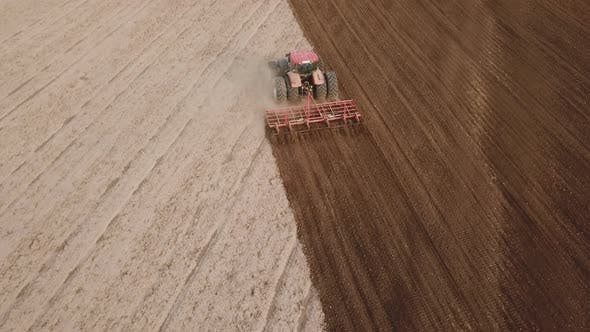 Thumbnail for Tractor Plows a Field