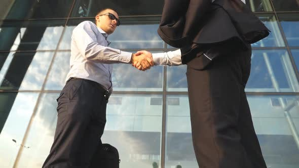Two Businessmen Meeting Near Office Building and Greeting Each Other. Business Handshake Outdoor in