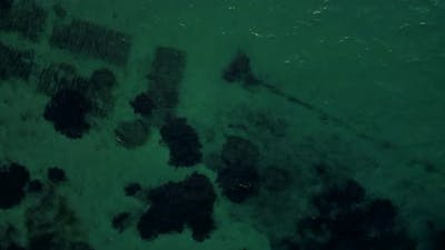 Drone Flying Over the Ocean with Coral Reef