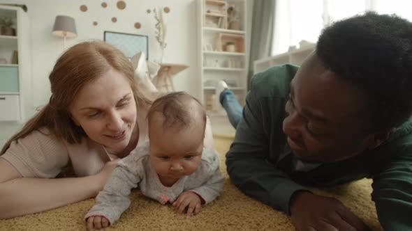 Thumbnail for Happy Multiethnic Parents Making Selfie with Kid