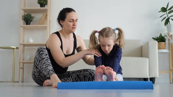 Mother with Daughter Doing Sports at Home