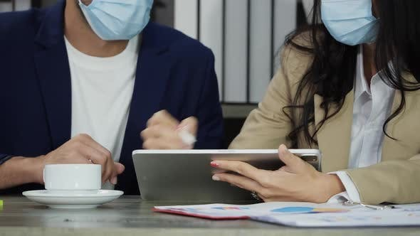 Business people in mask and working