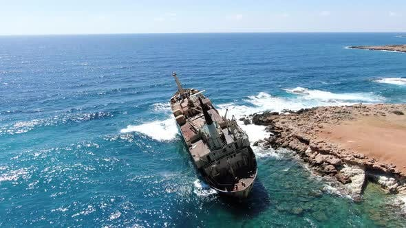 Thumbnail for Flying Over Coastline with Broken Ship