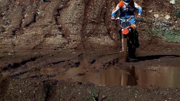 Cover Image for Motocross Biker Splashing Mud