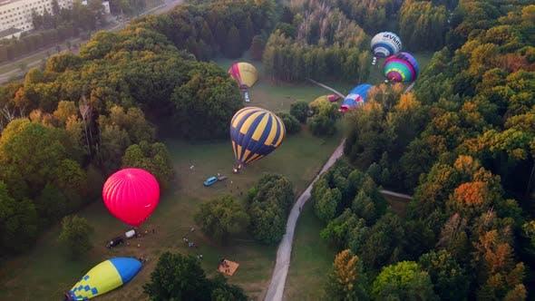 Thumbnail for Hot Air Balloons Preparing for Takeoff From Park at Summer Sunrise Hyperlapse