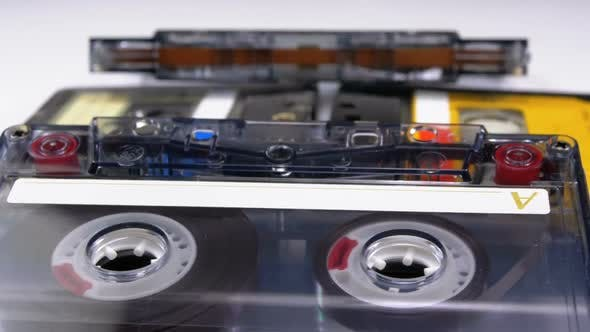 Four Audio Cassettes Rotate on White Background