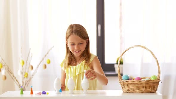 Thumbnail for Happy Girl Decorating Easter Eggs at Home