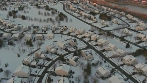 Blizzard Covers Roofs and Asphalt Roads Leading Through Tranquil Suburbs the Snow Covered Streets