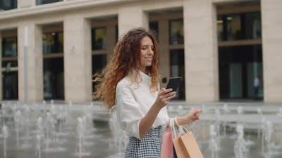 Successful Woman on Walk in Urban Area
