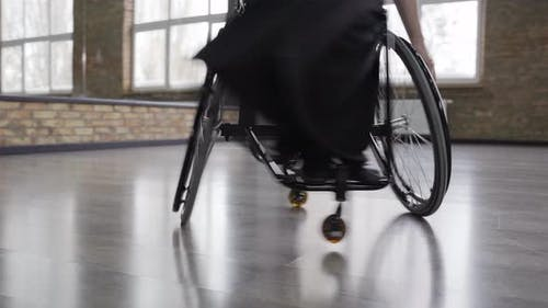 Wheelchair Spinning During Dance of Disabled Woman