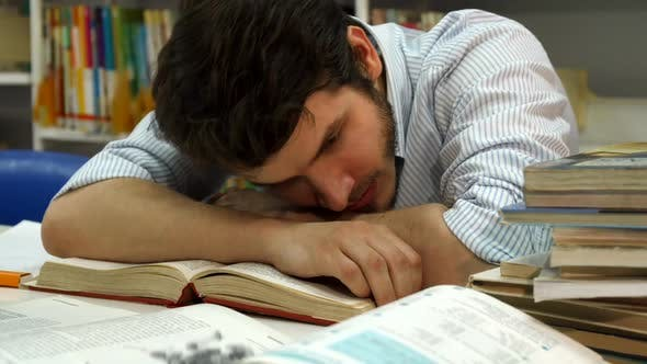 Thumbnail for Male Student Wakes Up at the Library