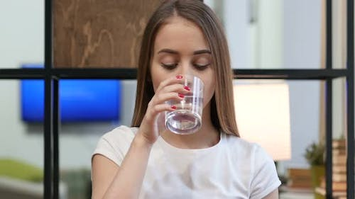 Portrait of Young Girl Drinking Water