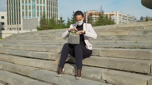 Bankruptcy Dismissed Woman Sitting on the Steps