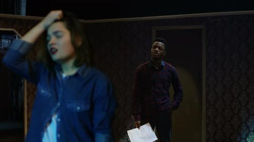 Actors Rehearsing in a Theater