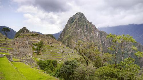 Machu Picchu landscape timelapse of the famous ancient Inca ruins in Peru. Time lapse of clouds over