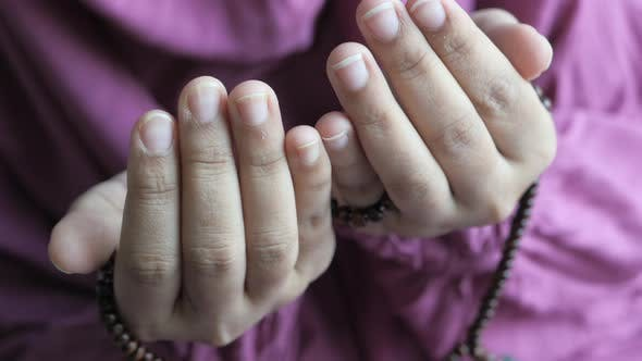 Thumbnail for Muslim Women Praying During Ramadan, Close Up
