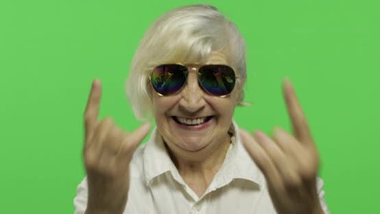 Thumbnail for An Elderly Woman Show Sign of the Horns with Her Hands. Chroma Key
