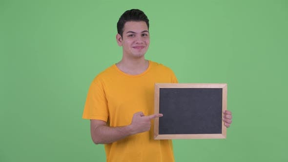 Cover Image for Happy Young Multi Ethnic Man Holding Blackboard and Giving Thumbs Up