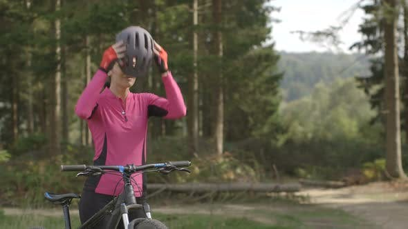 Woman getting ready for cycling