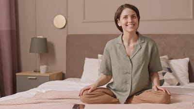 Woman in Loungewear Talking on Camera