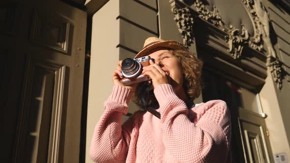 Thumbnail for Woman Tourist Taking Photos With Vintage Camera While Sightseeing In City