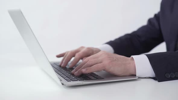 Thumbnail for Hands of Successful Businessman Typing on Laptop, Working on Project Report