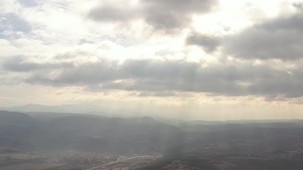 Sun rays through the cloudy sky 4K aerial video