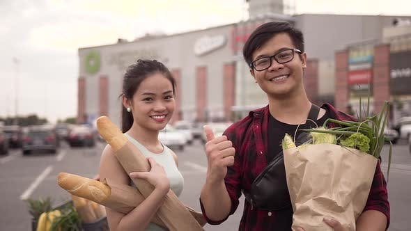 Thumbnail for Happy Cheerful Vietnamese People Standing with Food Bags