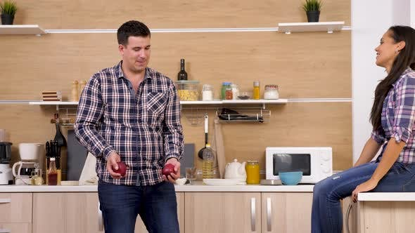Thumbnail for Man Juggling with Two Apples in Front of His Girlfriend