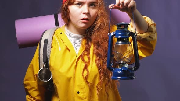 Beautiful Ginger Girl Holding a Lamp