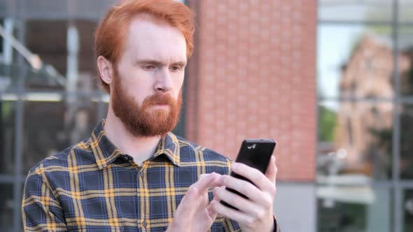 Thumbnail for Outdoor Redhead Man Using Smartphone