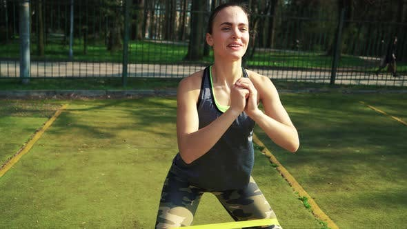 Sporty woman doing stretching exercises outdoor