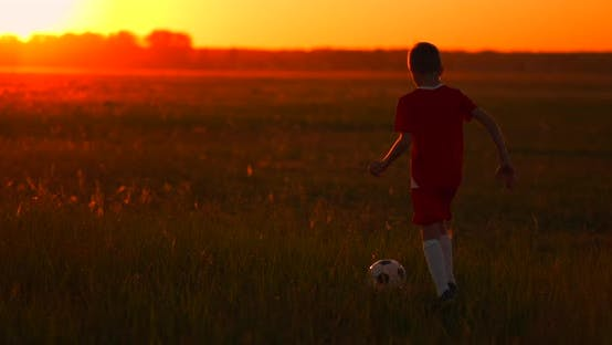 Thumbnail for An Action Sport Picture of a Group of Kid Playing Soccer Football for Exercise in Before the Sunset