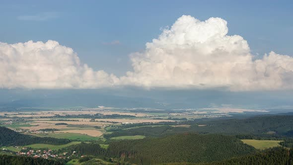 Cover Image for Clouds Towering over Rural Landscape and Fields in Summer Day