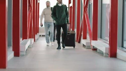 Passengers Walking Down Ramp