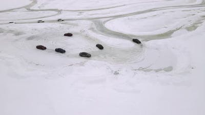 Drone Aerial View of Training Circuit on Frozen Lake with Sport Cars Training on It Before
