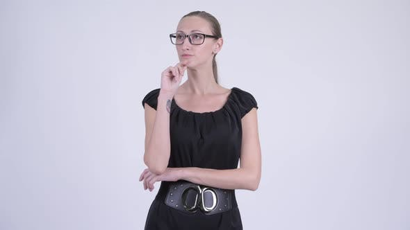 Thumbnail for Portrait of Blonde Businesswoman with Eyeglasses Thinking