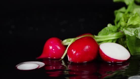 Thumbnail for Pieces of Ripe Radishes Fall Into the Water.