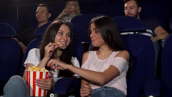 Thumbnail for Beautiful Young Women Enjoying Watching Movies at the Cinema