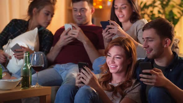 Cover Image for Friends with Smartphone Watching Tv at Home