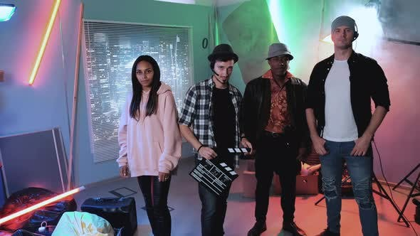 Thumbnail for Small Multiracial Film Crew Smiling To the Camera
