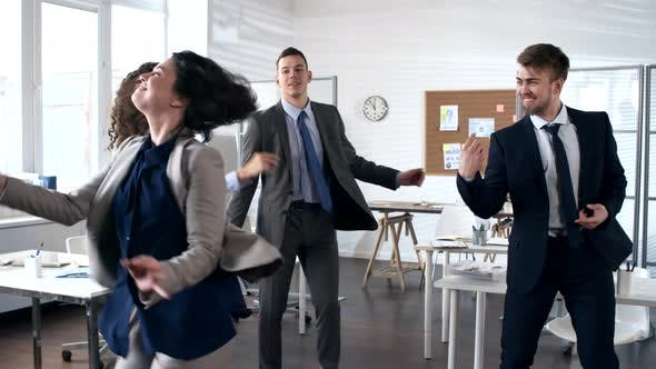 Cover Image for Carefree Business People Dancing Together in Office