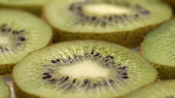 Thumbnail for Kiwi Slices Closeup, Macro Food Summer Background, Fruits Top View. Rotate